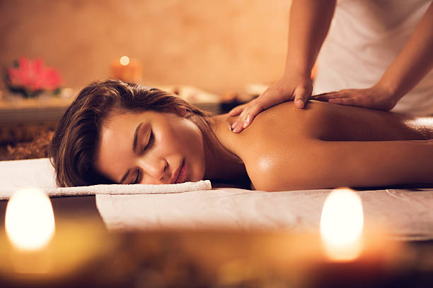 beautiful-woman-having-a-massage-at-the-spa-picture-id469917768