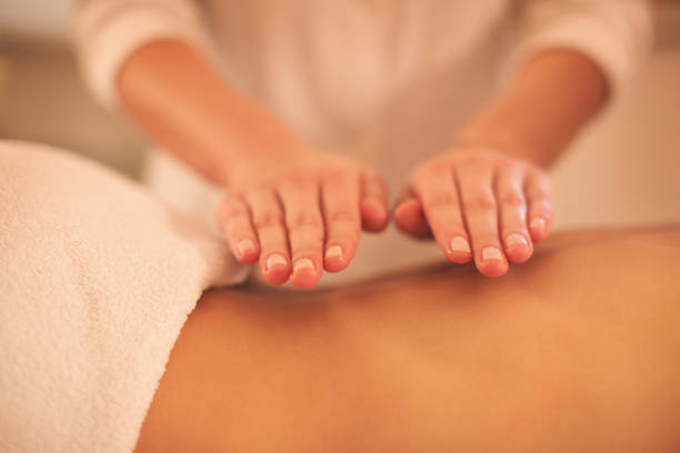 close-up-of-massage-therapyst-hands-picture-id646234872